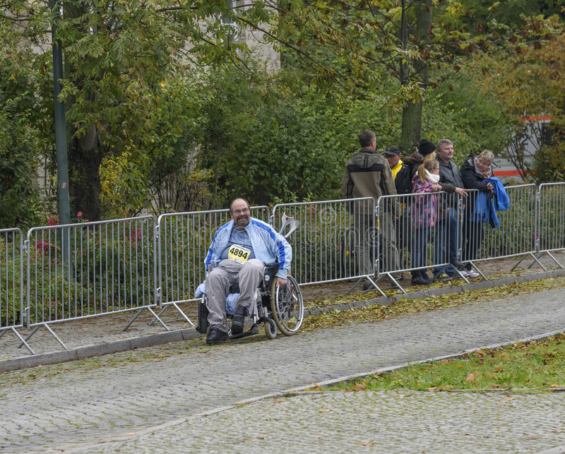 Elderly man in wheelchair is taking part in the race. Sport holiday marathon Germany Magdeburg oktober 2015. An elderly man in a wheelchair is also taking part royalty free stock photography
