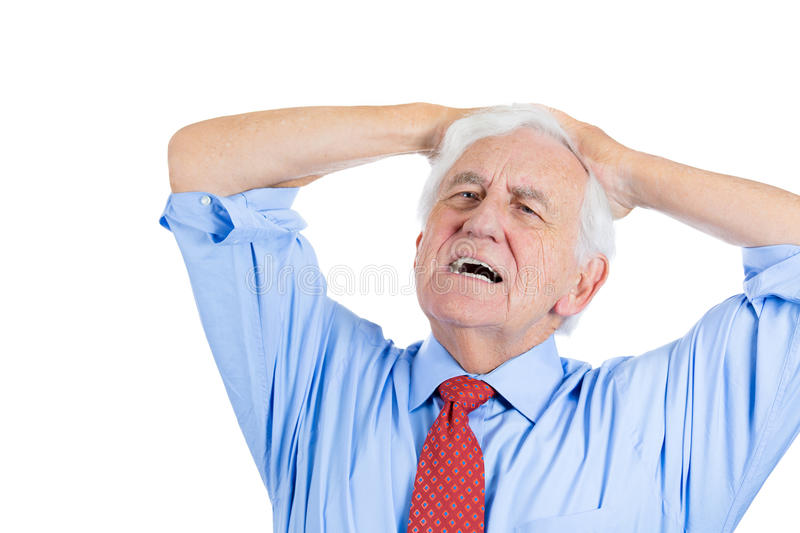 Elderly man with white hair in blue shirt and red tie, stressed and frustrated