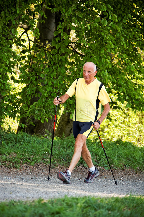 Free Elderly Man With Nordic Walking Royalty Free Stock Photography - 9126707