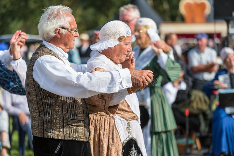 Elderly man and woman demonstrating an old Dutch folk dance during a Dutch festival royalty free stock photo