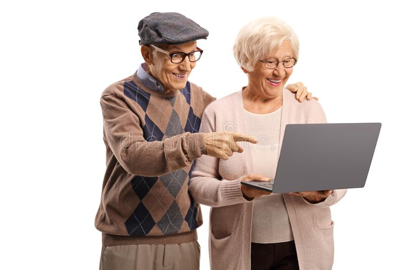 Elderly man and woman looking at a laptop computer stock photo
