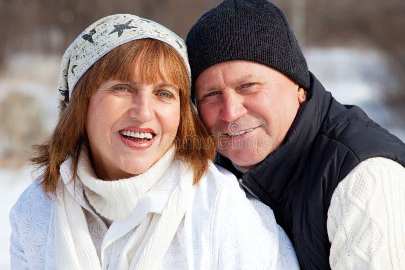 Elderly mature people. Happy seniors couple in winter park. Elderly mature people royalty free stock photography