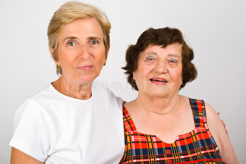 Elderly mother with mature daughter royalty free stock image
