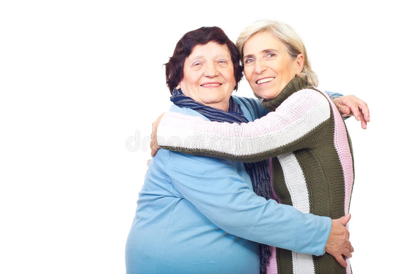 Elderly mother and senior daughter embrace royalty free stock photos