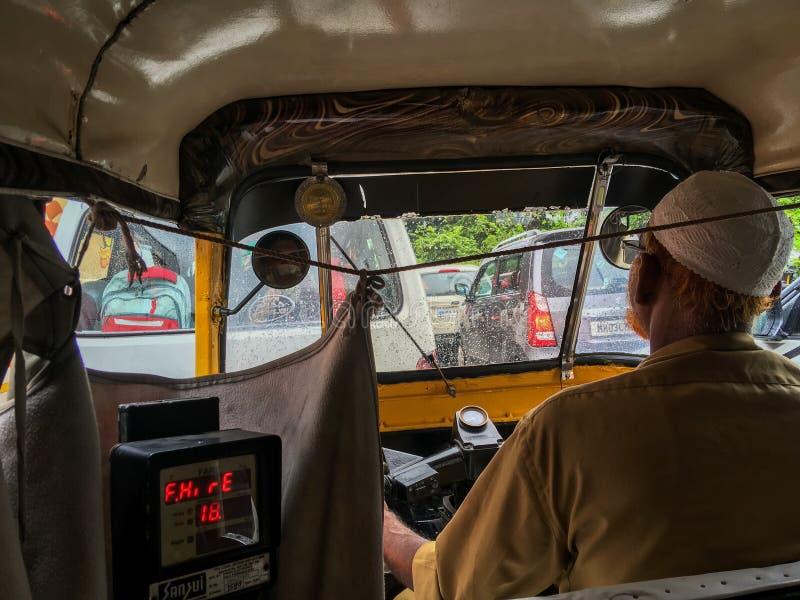 Elderly muslim rickshaw driver in james parked traffic Netivali near patri pul Kalyan royalty free stock image