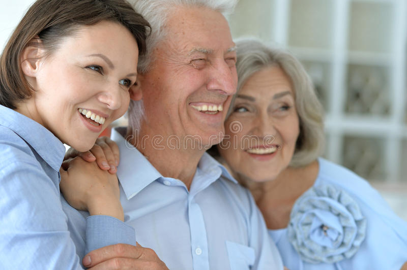 Elderly parents and their adult daughter stock photography