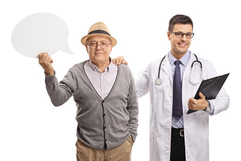 Elderly patient with a speech bubble and a doctor stock images