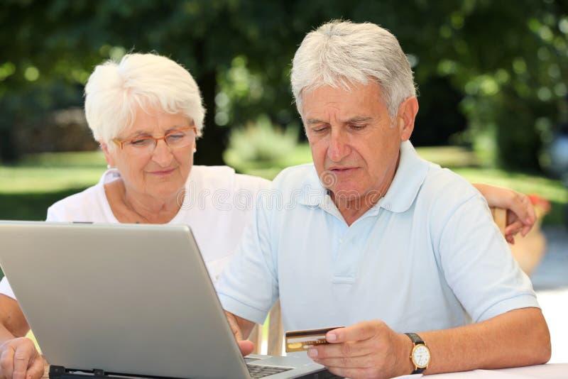 Elderly people and internet stock photos