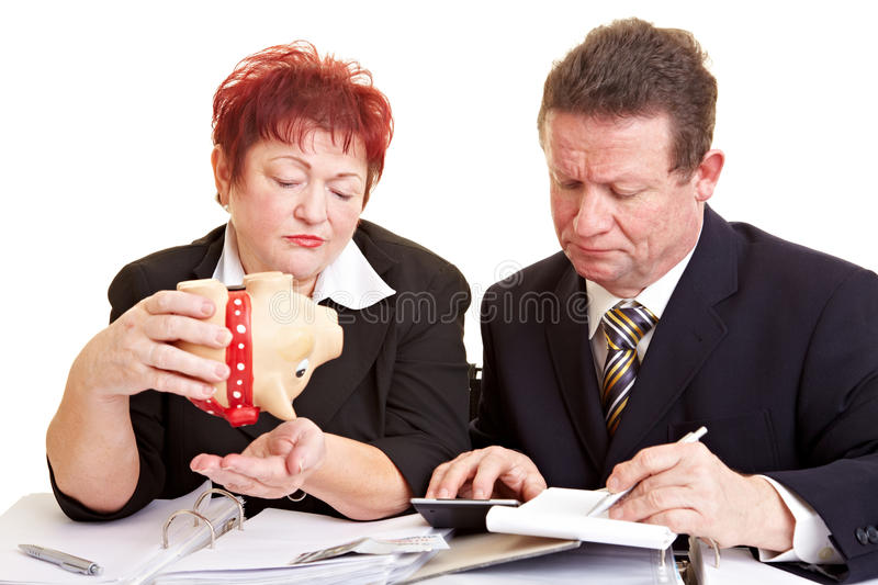 Elderly people with piggy bank royalty free stock photography