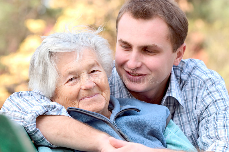 Elderly person with grandson royalty free stock photos