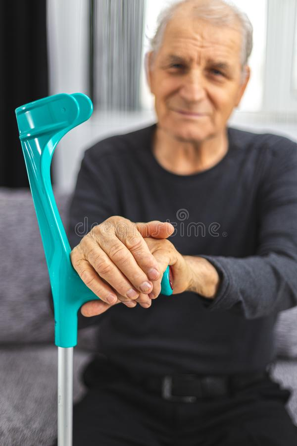 Free Elderly Person Standing With Hands Resting On Medical Walking Stick. Concept Of Person With Immobility, Joints, Rheumatism Problem Stock Photography - 168053742