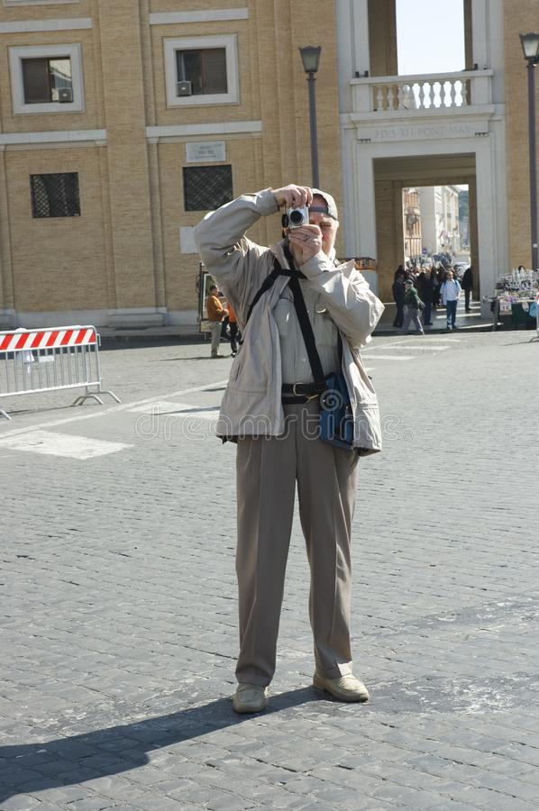 Elderly photographer tourist in Rome royalty free stock photos