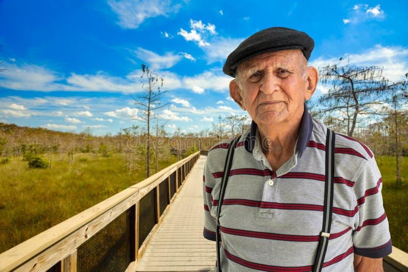 Elderly Man Outdoors. Elderly 80 plus year old man outdoor portrait enjoying the Florida Everglades stock photography