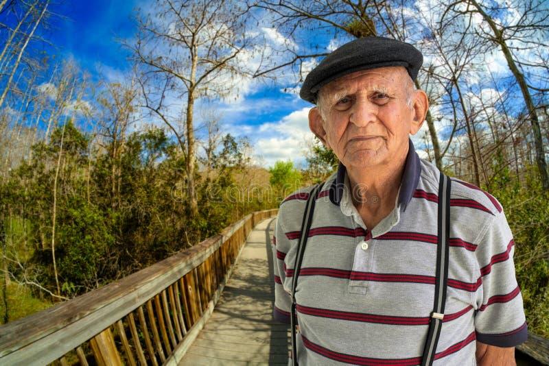 Elderly Man Outdoors. Elderly 80 plus year old man outdoor portrait enjoying the Florida Everglades stock photo