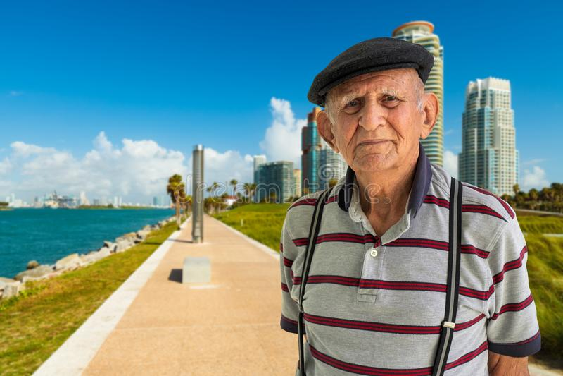 Elderly Man Outdoors. Elderly 80 plus year old man outdoor portrait enjoying Miami Beach royalty free stock photography