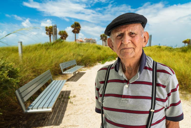 Elderly Man Outdoors. Elderly 80 plus year old man outdoor portrait enjoying Miami Beach stock photos