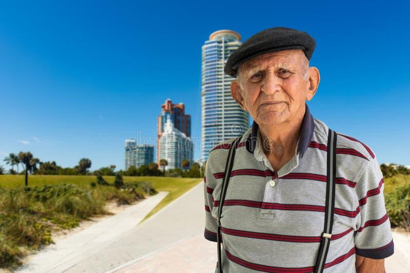 Elderly Man Outdoors. Elderly 80 plus year old man outdoor portrait enjoying Miami Beach royalty free stock images