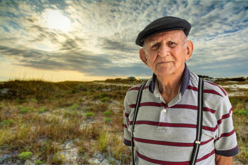 Elderly Man Outdoors. Elderly 80 plus year old man outdoor portrait enjoying a North Florida dunes beach royalty free stock image