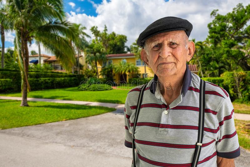 Elderly Man Outdoors. Elderly 80 plus year old man outdoor portrait standing in front of a home stock photo