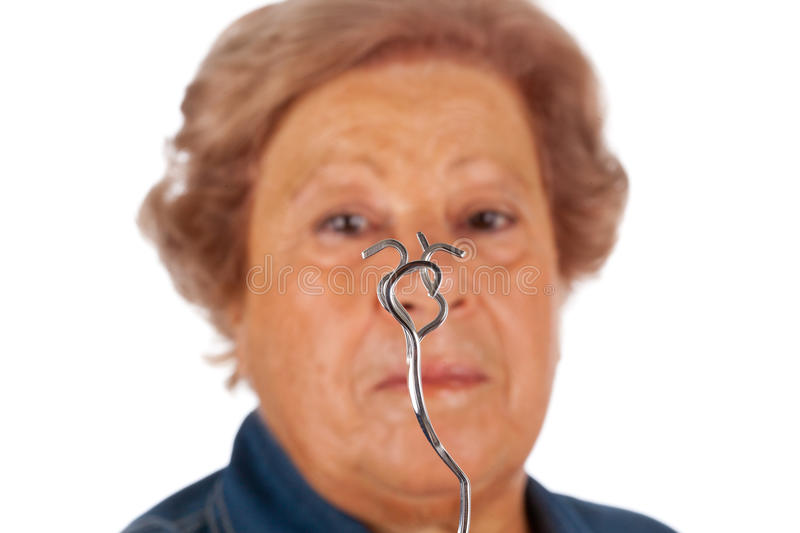 Elderly with psychokinetic abilities bend fork. Elderly woman with psychokinetic abilities bend metal fork royalty free stock photo
