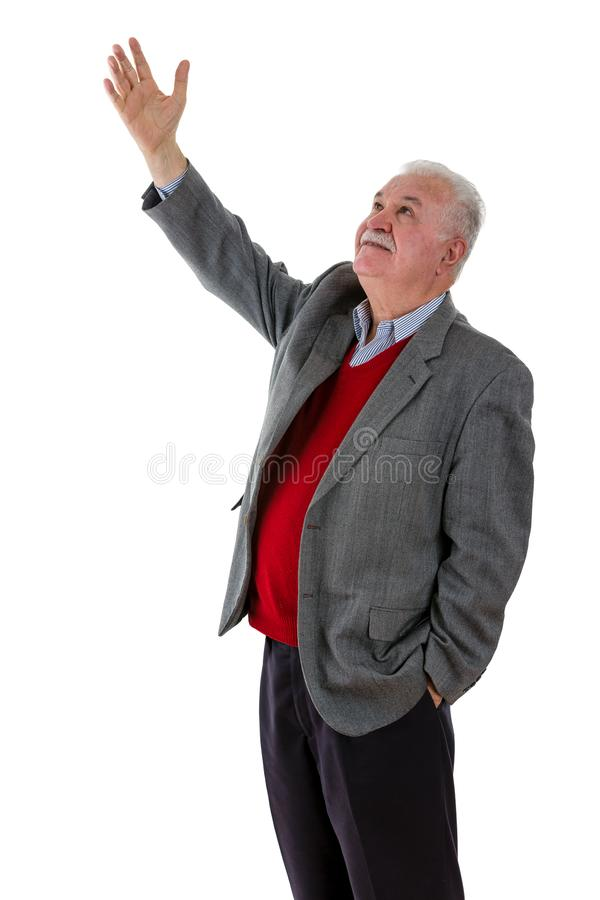 Elderly retired man raising his hand in the air royalty free stock photo