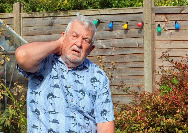 Neck pain. Arthritis. Stiff neck. Elderly or senior man holding his neck because of pains. Arthritis royalty free stock photo