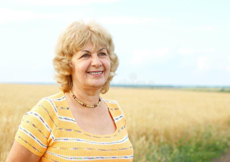 Elderly senior woman. Smiling happy elderly senior woman stock image