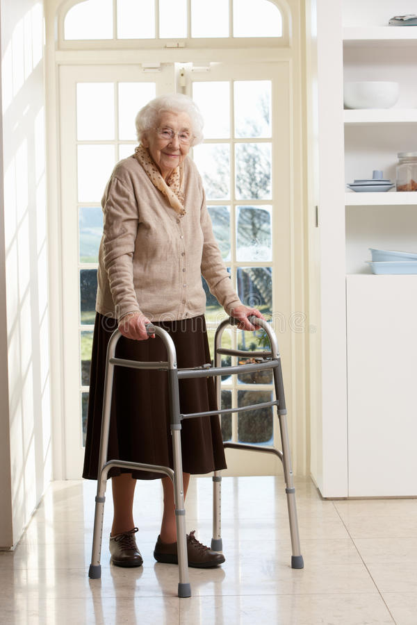 Elderly Senior Woman Using Walking Frame. Smiling stock images