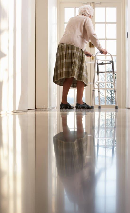 Elderly Senior Woman Using Walking Frame royalty free stock photos