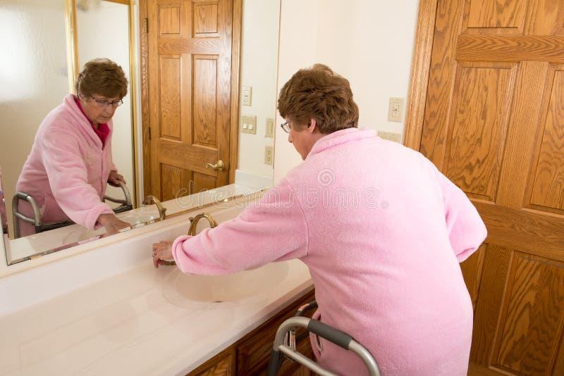 Elderly Senior Woman Washing Up stock photography