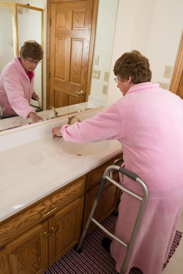 Elderly Senior Woman Washing Up royalty free stock images