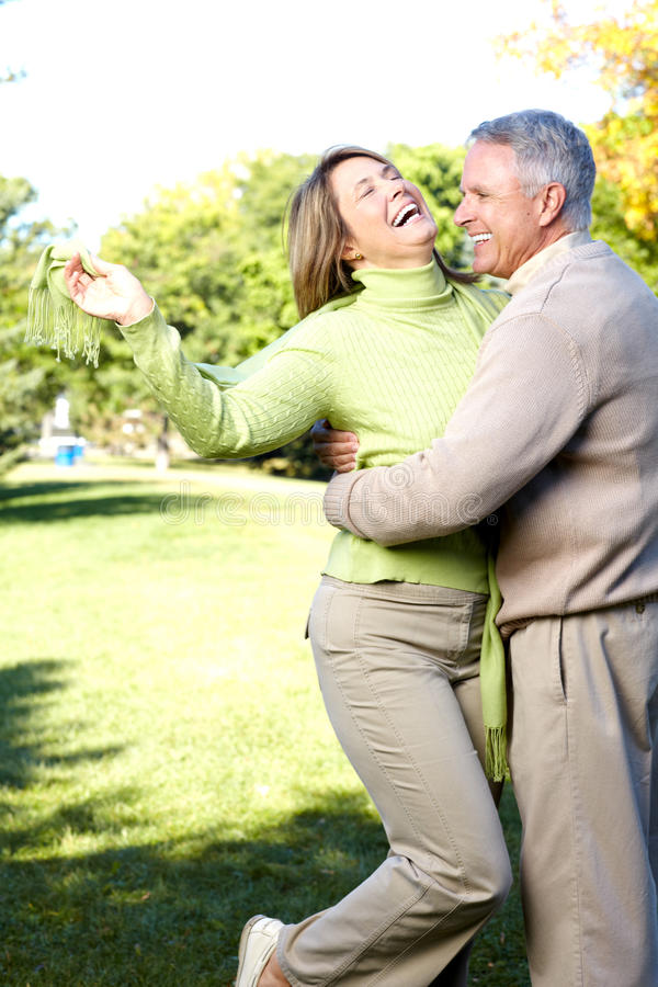 Elderly seniors couple. Happy elderly seniors couple in park stock image