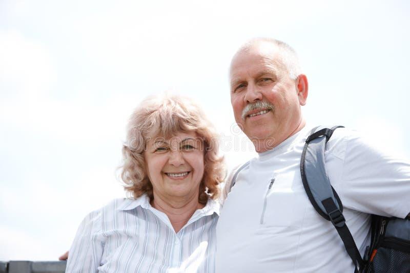 Elderly seniors couple. Happy elderly seniors couple in park stock photography