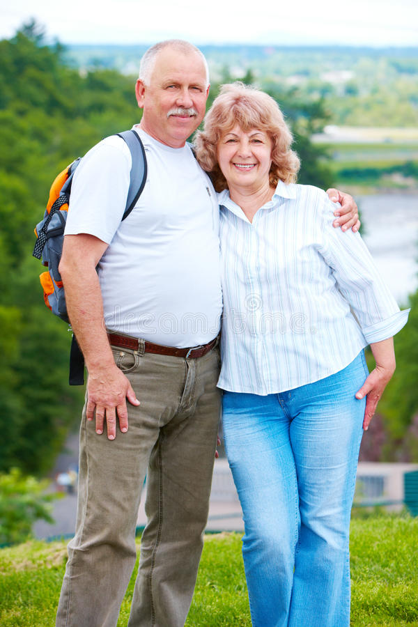 Elderly seniors couple. Happy elderly seniors couple in park stock photos