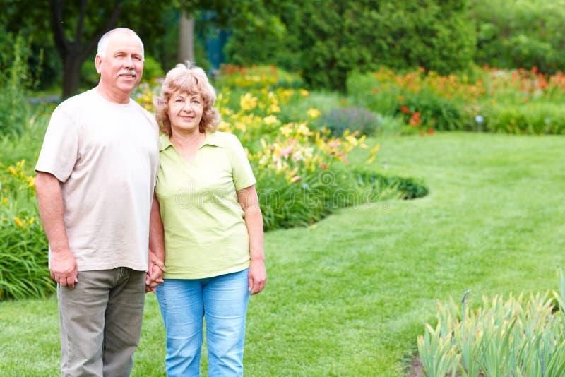 Elderly seniors couple. Happy elderly seniors couple in park royalty free stock photography