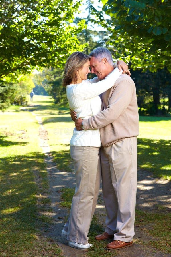 Elderly seniors couple. Happy elderly seniors couple in park royalty free stock photo