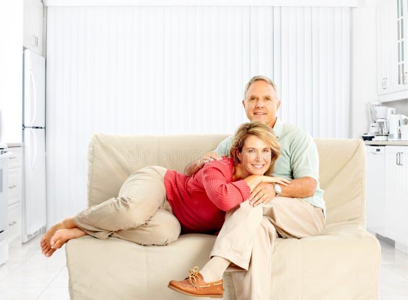 Elderly seniors couple. Happy elderly seniors couple. Isolated over white background royalty free stock image