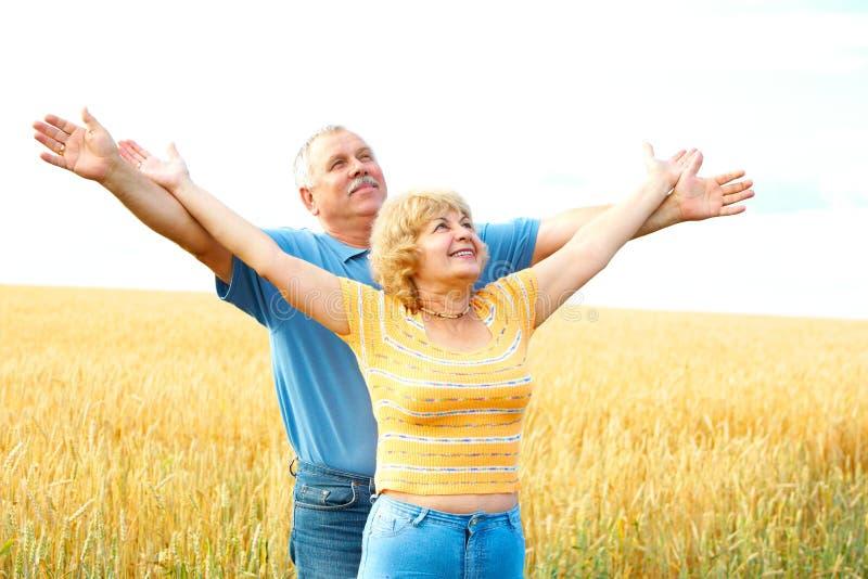 Elderly seniors couple. Smiling happy elderly seniors couple outdoor royalty free stock photography