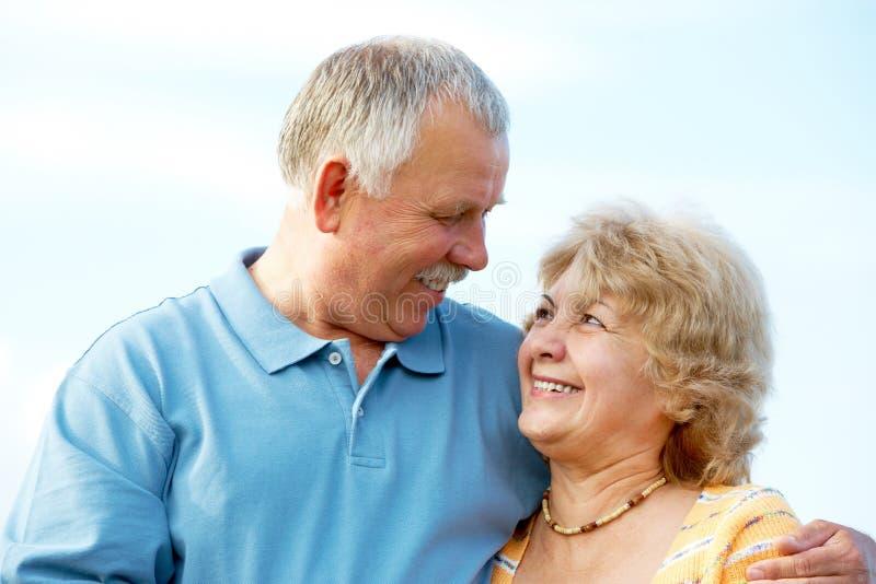 Elderly seniors couple. Smiling happy elderly seniors couple outdoor stock photo