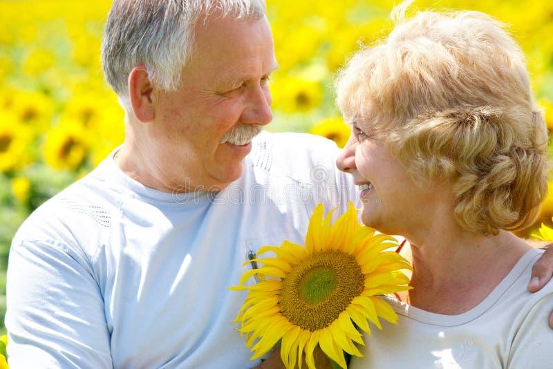 Elderly seniors couple. Smiling happy elderly seniors family outdoor stock photos