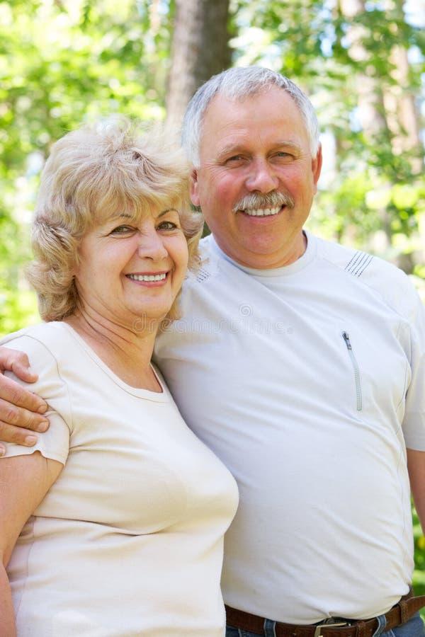 Elderly seniors couple. Happy elderly seniors couple in park royalty free stock photos