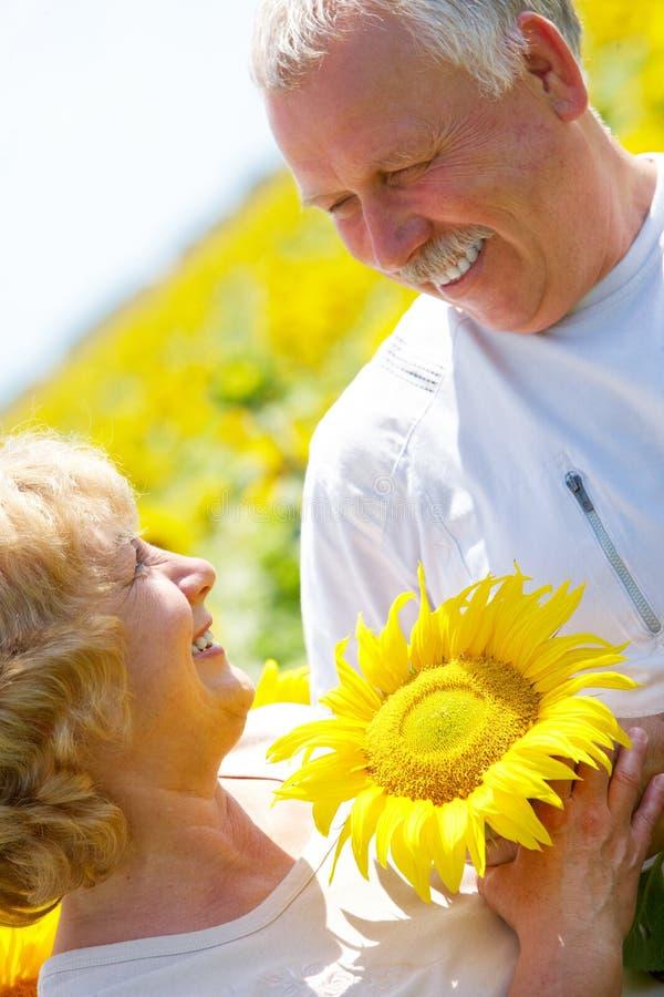 Elderly seniors couple. Smiling happy elderly seniors family outdoor stock photo