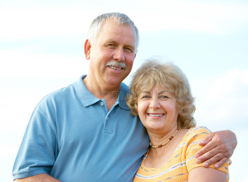 Elderly seniors couple. Smiling happy elderly seniors couple outdoor royalty free stock photos
