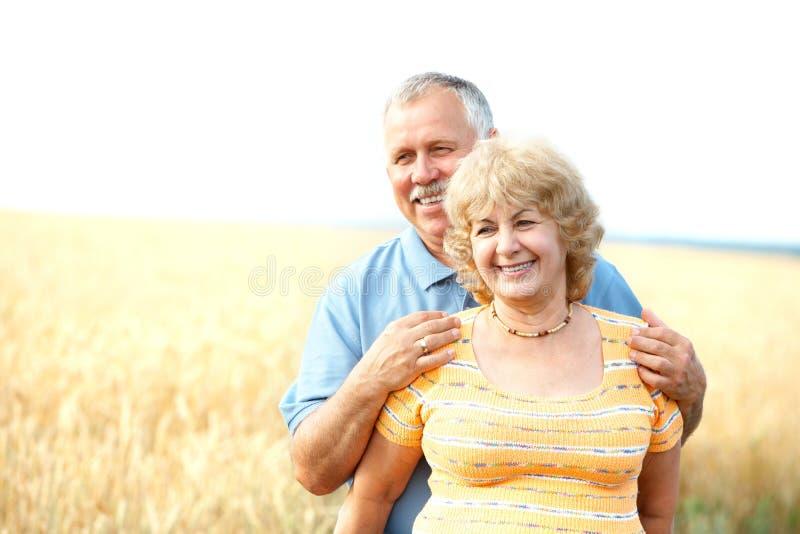Elderly seniors couple. Smiling happy elderly seniors couple outdoor stock photos