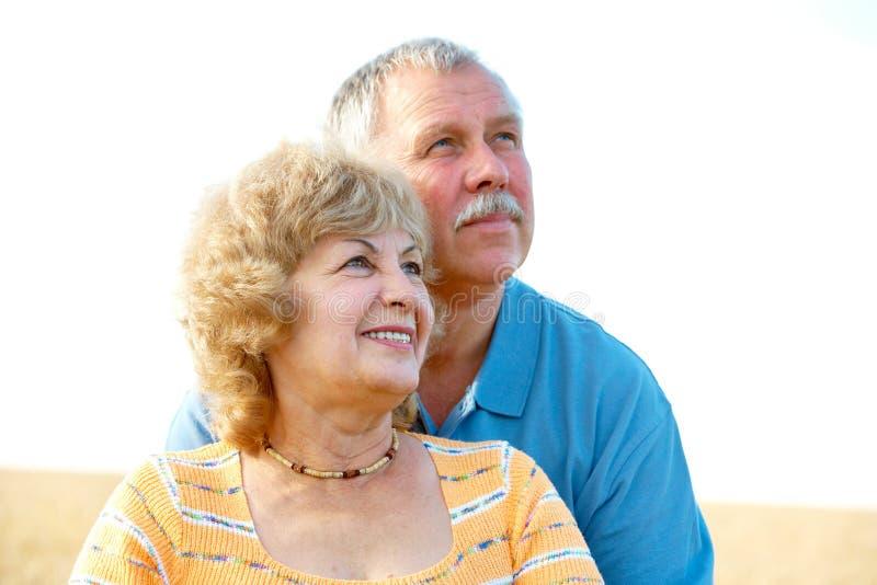 Elderly seniors couple. Smiling happy elderly seniors couple outdoor stock images