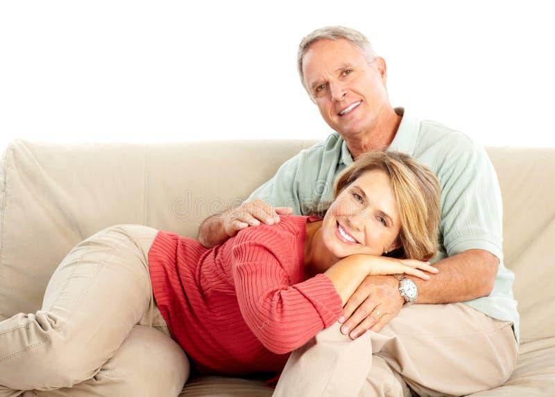 Elderly seniors couple. Happy elderly seniors couple. Isolated over white background royalty free stock photos