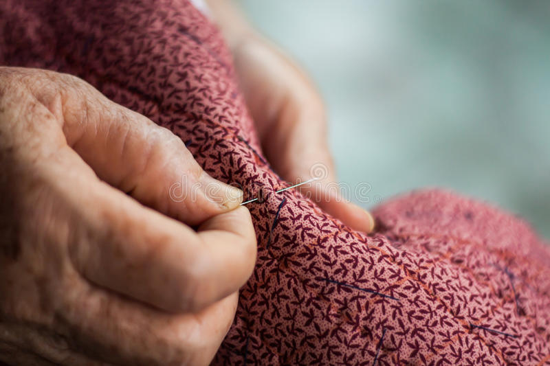 Elderly sewing as a hobby stock photo