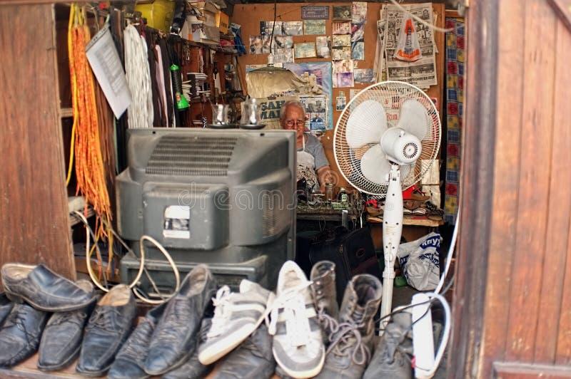 Elderly shoe repairman royalty free stock photos