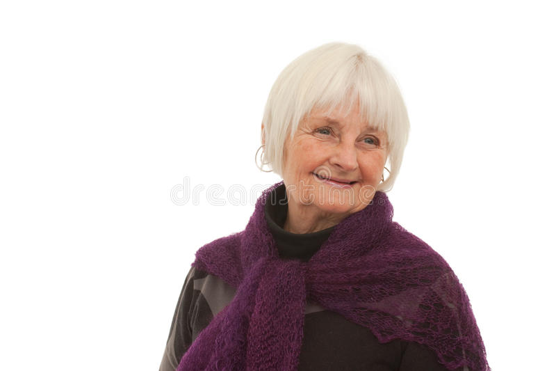 Elderly - smiling older woman. Beside copyspace on white royalty free stock image