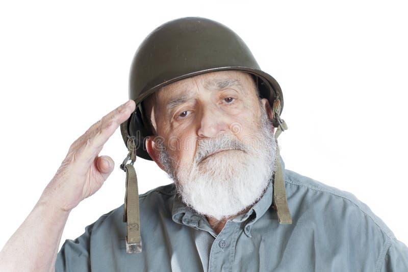 Elderly soldier veteran saluting. Senior soldier veteran saluting isolated on white background royalty free stock image